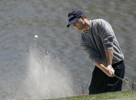 Zach Johnson fires his ball out of the bunker around the 17th green during the third round of the MCI Heritage at Harbour Town Golf Links April 16, 2005, at Hilton Head Island.Photo by Kevin Cox/WireImage.com