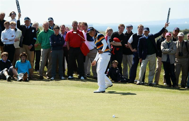 GULLANE, SCOTLAND - JUNE 19:  Jin Jeong of South Korea celebrates beating James Byrne of Scotland 5&4 to win The Amateur Championship at Muirfield Golf Club on June 19, 2010 in Gullane, Scotland.  (Photo by Warren Little/Getty Images)