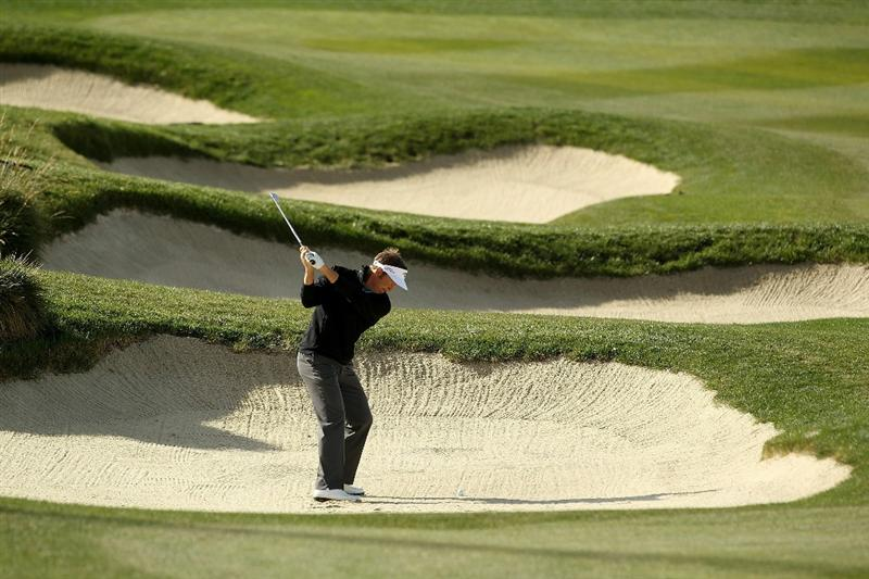 PEBBLE BEACH, CA - FEBRUARY 13:  Stuart Appleby of Australia hits out of a bunker on the 6th hole during the final round of the AT&T Pebble Beach National Pro-Am at the Pebble Beach Golf Links on February 13, 2011 in Pebble Beach, California.  (Photo by Ezra Shaw/Getty Images)