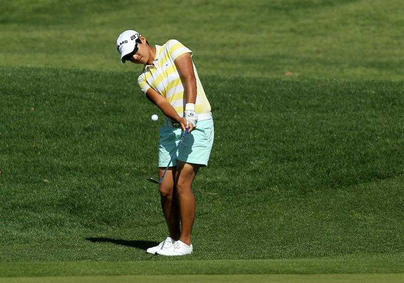 RANCHO MIRAGE, CA - APRIL 04:  Yani Tseng of Taiwan chips in for an eagle on the second hole during the final round of the Kraft Nabisco Championship at Mission Hills Country Club on April 4, 2010 in Rancho Mirage, California.  (Photo by Stephen Dunn/Getty Images)