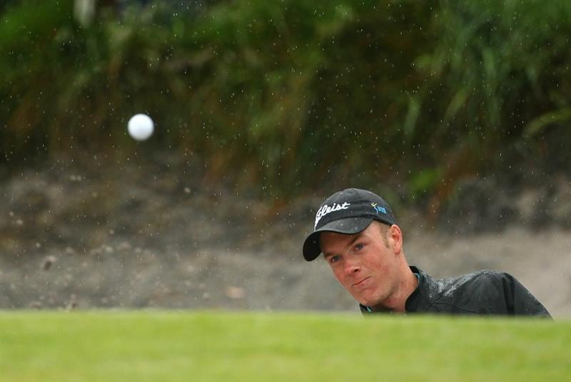 MELBOURNE, AUSTRALIA - NOVEMBER 13:  Kieran Pratt of Australia hits his shot out of the bunker during round three of the Australian Masters at The Victoria Golf Club on November 13, 2010 in Melbourne, Australia.  (Photo by Robert Cianflone/Getty Images)