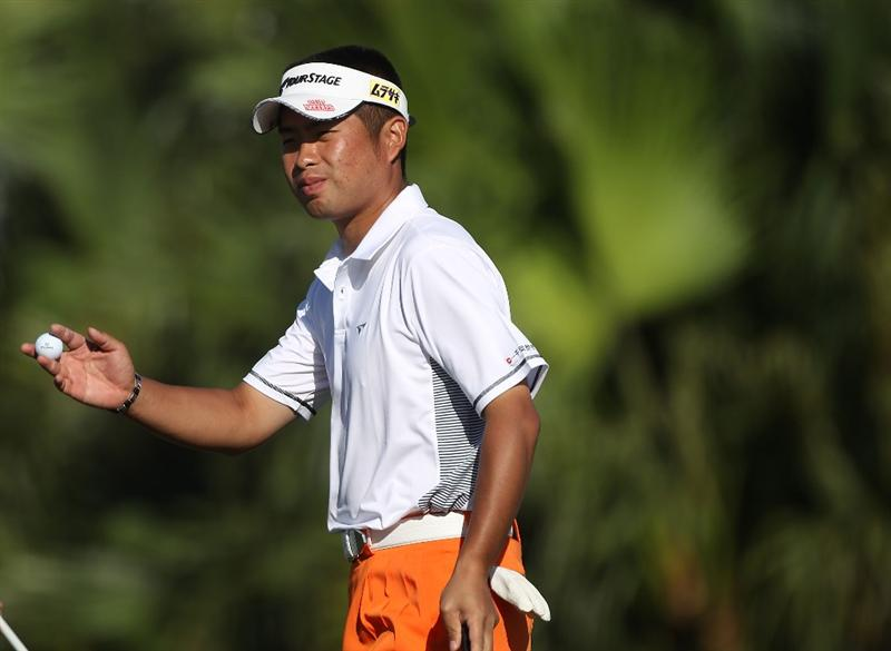 DORAL, FL - MARCH 13:  Yuta Ikeda of Japan acknowledges the gallery on the 12th hole during round three of the 2010 WGC-CA Championship at the TPC Blue Monster at Doral on March 13, 2010 in Doral, Florida.  (Photo by Scott Halleran/Getty Images)