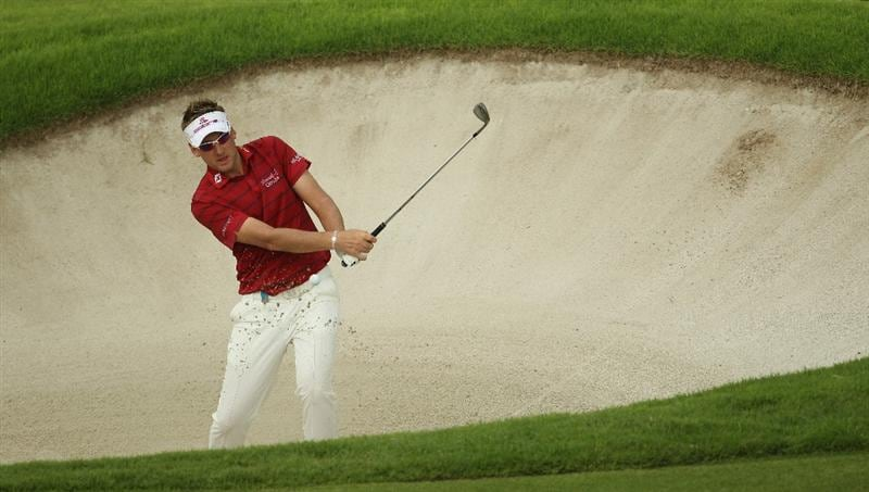 SINGAPORE - NOVEMBER 14:  Ian Poulter of England in action during the Final Round of the Barclays Singapore Open at Sentosa Golf Club on November 14, 2010 in Singapore, Singapore.  (Photo by Ian Walton/Getty Images)