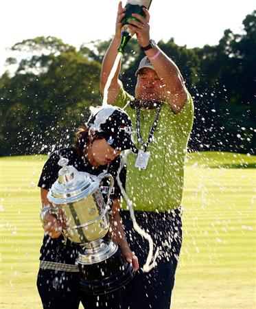 BETHLEHEM, PA - JULY 12:  En Hee Ji of South Korea is sprayed with champagne by Paul Park of Hana Bank after her one-stroke victory at the 2009 U.S. Women's Open at the Saucon Valley Country Club on July 12, 2009 in Bethlehem, Pennsylvania.  (Photo by Scott Halleran/Getty Images)