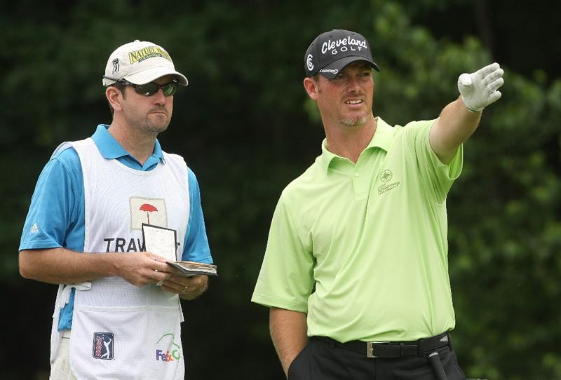 CROMWELL, CT - JUNE 25: Tag Ridings talks with his caddie during round one of the 2009 Travelers Championship at TPC River Highlands on June 25, 2009 in Cromwell, Connecticut. (Photo by Jim Rogash/Getty Images)