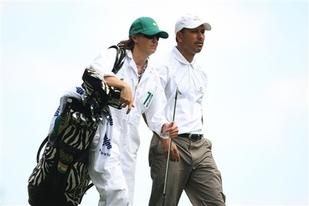 AUGUSTA, GA - APRIL 11:  Jeev Milkha Singh of India walks off the fourth hole with his caddie Janet Squire during the second round of the 2008 Masters Tournament at Augusta National Golf Club on April 11, 2008 in Augusta, Georgia.  (Photo by Andrew Redington/Getty Images)