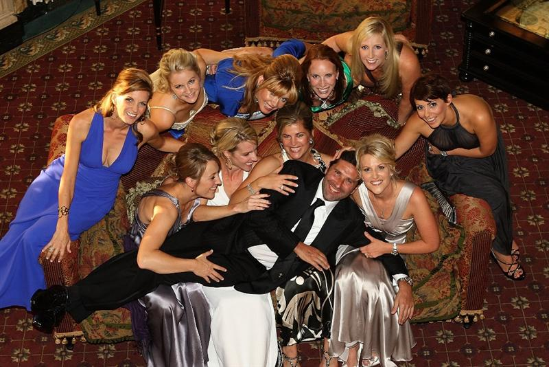 LOUISVILLE, KY - SEPTEMBER 17:  European Ryder Cup team assistant captain Jose Maria Olazabal poses with wives and partners of the European team at the Brown Hotel prior to the start of the 2008 Ryder Cup on September 17, 2008 in Louisville, Kentucky.  (Photo by Ross Kinnaird/Getty Images)