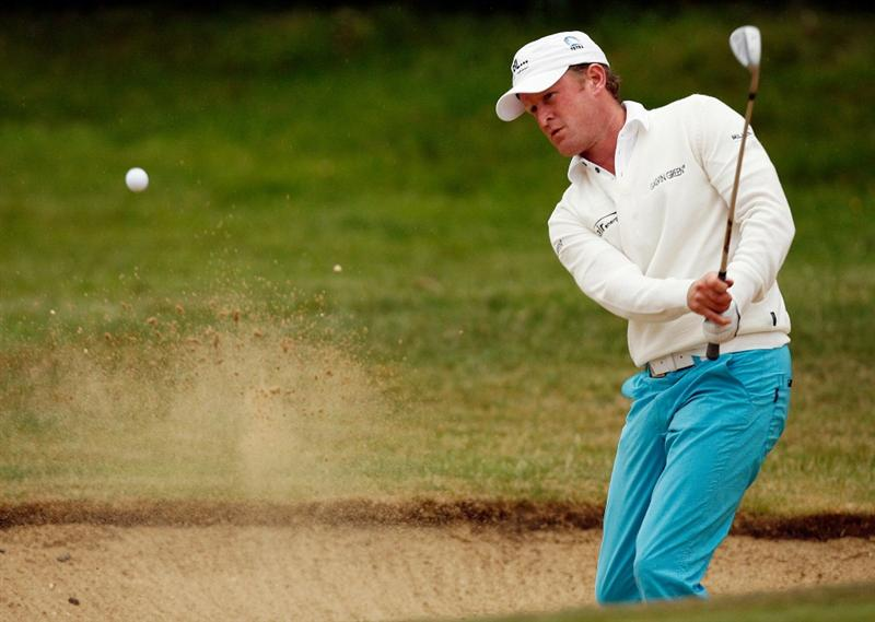SUNNINGDALE, UNITED KINGDOM - JUNE 07: Jamie Donaldson of Wales plays out of a greenside bunker on the 1st green during the play-off on the New Course during The Open Championship International Final Qualifying at Sunningdale Golf Club on June 7, 2010 in Sunningdale, England. (Photo by Glyn Kirk/Getty Images)