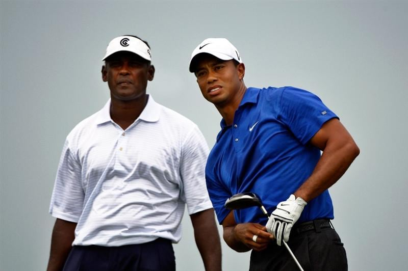 CHASKA, MN - AUGUST 15:  Tiger Woods watches his tee shot on the first hole as Vijay Singh of Fiji looks on during the third round of the 91st PGA Championship at Hazeltine National Golf Club on August 15, 2009 in Chaska, Minnesota.  (Photo by Streeter Lecka/Getty Images)