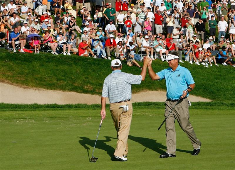 CROMWELL, CT - JUNE 28: Kenny Perry (R) congratulates Paul Goydos after Goydos birdied the 18th hole during the 2009 Travelers Championship at TPC River Highlands on June 28, 2009 in Cromwell, Connecticut. (Photo by Jim Rogash/Getty Images)