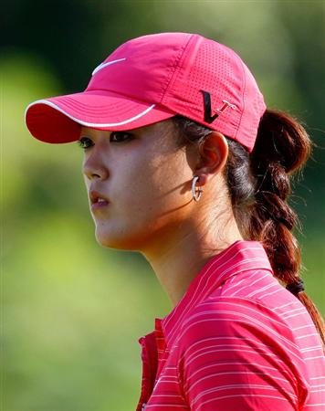 GUADALAJARA, MEXICO - NOVEMBER 15:  Michelle Wie of the United States awaits her par putt on the 17th green during the final round of the Lorena Ochoa Invitational Presented by Banamex and Corona at Guadalajara Country Club on November 15, 2009 in Guadalajara, Mexico.  (Photo by Kevin C. Cox/Getty Images)
