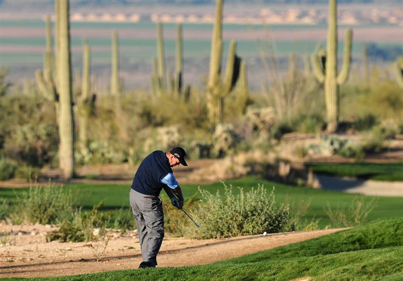MARANA, AZ - FEBRUARY 28:  Ernie Els of South Africa plays his approach shot on the second hole during the quarter final round of Accenture Match Play Championships at Ritz - Carlton Golf Club at Dove Mountain on February 28, 2009 in Marana, Arizona.  (Photo by Stuart Franklin/Getty Images)