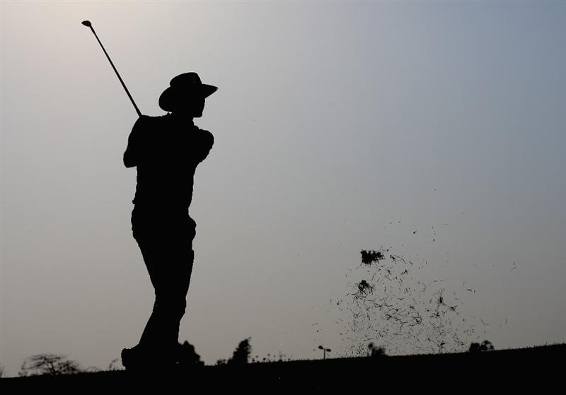 DOHA, QATAR - JANUARY 25:  Alvaro Quiros of Spain plays his second shot on the par four 14th hole during the final round of the Commercialbank Qatar Masters at the Doha Golf Club on January 25,2009 in Doha, Qatar.  (Photo by Ross Kinnaird/Getty Images)