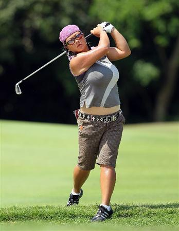 SINGAPORE - FEBRUARY 26: Christina Kim of the USA hits her second shot on the 4th hole during the second round of the HSBC Women's Champions at Tanah Merah Country Club on February 26, 2010 in Singapore, Singapore.  (Photo by Andy Lyons/Getty Images)