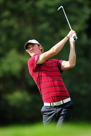HILVERSUM, NETHERLANDS - SEPTEMBER 09:  Chris Wood of England plays his approach shot on the sixth hole during the first round of  The KLM Open Golf at The Hillversumsche Golf Club on September 9, 2010 in Hilversum, Netherlands  (Photo by Stuart Franklin/Getty Images)