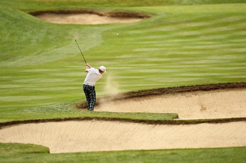WENTWORTH, ENGLAND - MAY 23:  Jamie Donaldson of Wales plays his second shot out of the bunker on the 4th hole during the Third Round of the BMW PGA Championship at Wentworth on May 23, 2009 in Virginia Water, England.  (Photo by Ross Kinnaird/Getty Images)