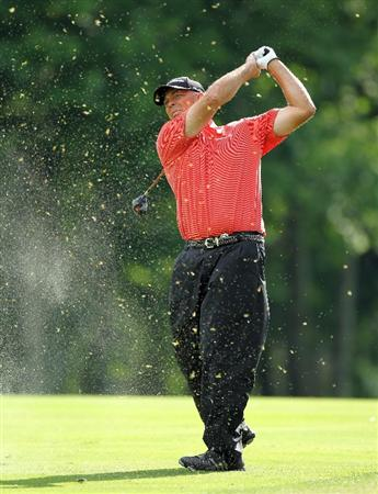 LOUISVILLE, KY - MAY 26:  Tom Lehman hits his second shot on the par 5 10th hole during the first round of the Senior PGA Championship presented by KitchenAid at Valhalla Golf Club on May 26, 2011 in Louisville, Kentucky.  (Photo by Andy Lyons/Getty Images)