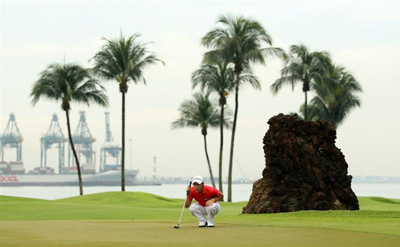 SINGAPORE - NOVEMBER 13:  Kang Kyung-nam of Korea lines up a put during the Final Round of the Barclays Singapore Open at Sentosa Golf Club on November 14, 2010 in Singapore, Singapore.  (Photo by Ian Walton/Getty Images)