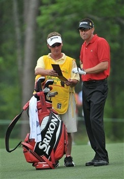 HUMBLE, TX - APRIL 4:  Robert Allenby (R) of Australia prepares to hit his approach shot to the second hole during the second round of the 2008 Shell Houston Open at the Redstone Golf Club April 4, 2008 in Humble, Texas.  (Photo by Marc Feldman/Getty Images)