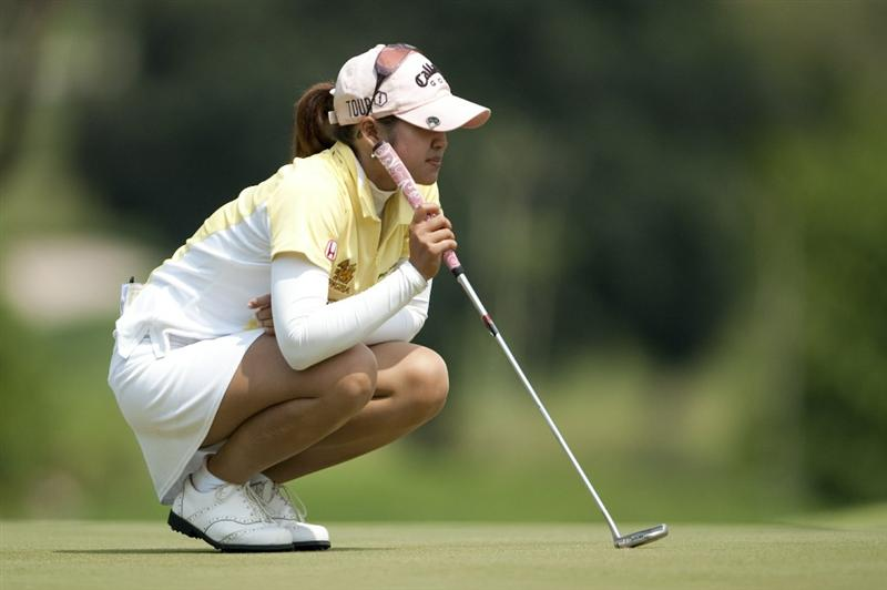 CHON BURI, THAILAND - FEBRUARY 18:  Pornanong Phatlum of Thailand lines up a putt on the 2nd green during day two of the LPGA Thailand at Siam Country Club on February 18, 2011 in Chon Buri, Thailand.  (Photo by Victor Fraile/Getty Images)