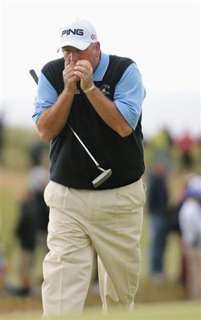 TURNBERRY, SCOTLAND - JULY 17:   Mark Calcavecchia of USA blows on his hands for warmth on the 15th green during round two of the 138th Open Championship on the Ailsa Course, Turnberry Golf Club on July 17, 2009 in Turnberry, Scotland.  (Photo by Harry How/Getty Images)