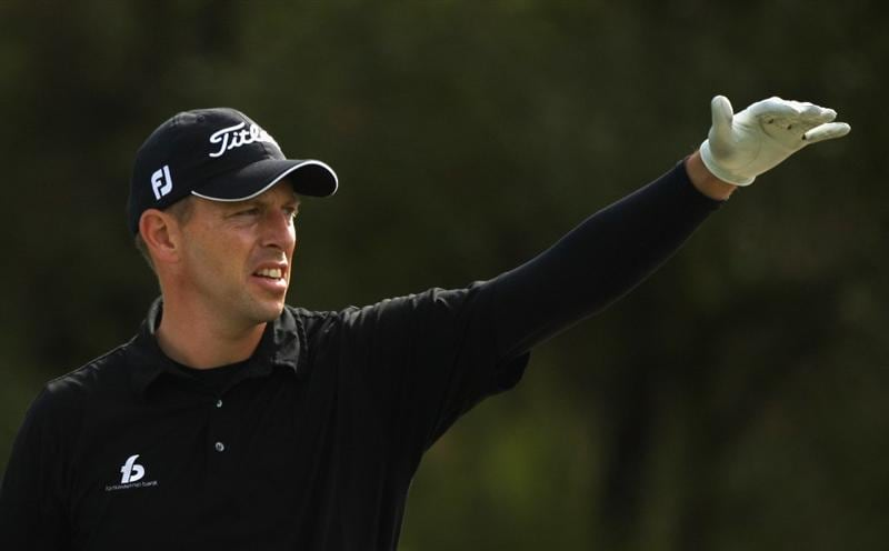 GIRONA, SPAIN - MAY 01:  Soren Hansen of Denmark points out the line of a shot to his caddie during the second round of the Open de Espana at the PGA Golf Catalunya on May 1, 2009 in Girona, Spain.  (Photo by Warren Little/Getty Images)