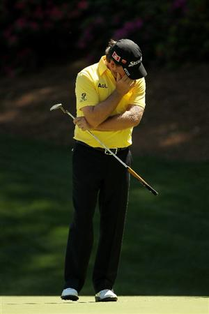 AUGUSTA, GA - APRIL 07:  Graeme McDowell of Northern Ireland reacts to a missed putt during the first round of the 2011 Masters Tournament at Augusta National Golf Club on April 7, 2011 in Augusta, Georgia.  (Photo by Jamie Squire/Getty Images)
