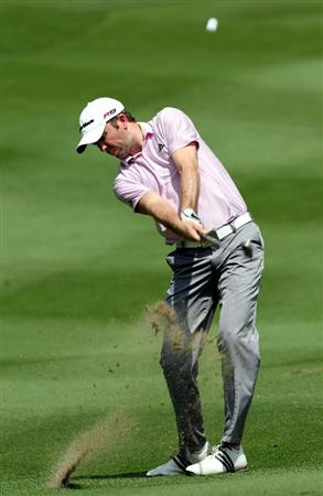 KUALA LUMPUR, MALAYSIA - OCTOBER 28: Martin Laird of Scotland plays his 2nd shot on the 1st hole during day one of the CIMB Asia Pacific Classic at The MINES Resort & Golf Club on October 28, 2010 in Kuala Lumpur, Malaysia. (Photo by Stanley Chou/Getty Images)