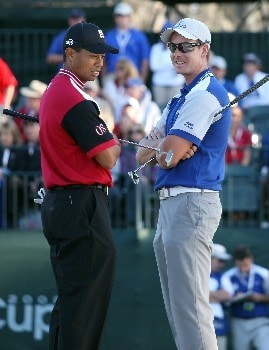 ORLANDO, FL - MARCH 24:  Tiger Woods (L), of the Isleworth team, and Henrik Stenson of Sweden and the Lake Nona Team stnad on the 18th green during the first day's play of the Tavistock Cup at Isleworth Golf and Country Club March 24, 2008 in Orlando, Florida.  (Photo by David Cannon/Getty Images)