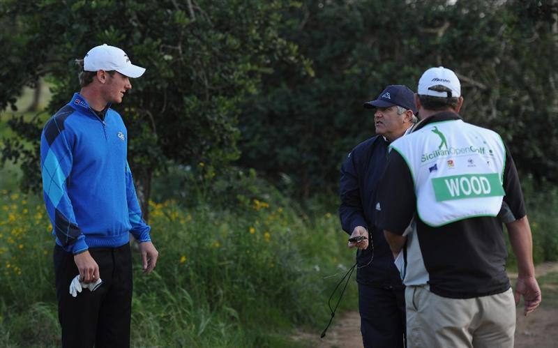 RAGUSA, ITALY - MARCH 18:  Chris Wood of England and a rules official discuss the amount of time searched for a ball on the 18th hole during the second round of the Sicilian Open at the Donnafugata golf resort and spa on March 18, 2011 in Ragusa, Italy.  (Photo by Stuart Franklin/Getty Images)