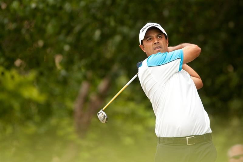 IRVING, TX - MAY 23: Arjun Atwal of India follows through on a tee shot during the fourth round of the HP Byron Nelson Championship at TPC Four Seasons Resort Las Colinas on May 23, 2010 in Irving, Texas. (Photo by Darren Carroll/Getty Images)