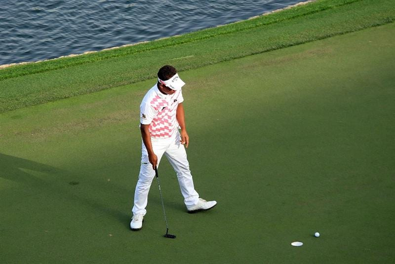 DUBAI, UNITED ARAB EMIRATES - FEBRUARY 07:  Thongchai Jaidee of Thailand misses from four feet at the 18th hole which woul dhave got him into the play-off during the final round of the 2010 Omega Dubai Desert Classic on the Majilis Course at the Emirates Golf Club on February 7, 2010 in Dubai, United Arab Emirates.  (Photo by David Cannon/Getty Images)