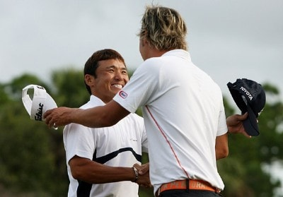 Shigeki Maruyama and Fredrik Jacobson congratulate each other on the 18th green after the final round of the Ginn Sur Mer Classic at Tesoro on October 29, 2007 in Port Saint Lucie, Florida. PGA TOUR - 2007 Ginn sur Mer Classic - Final RoundPhoto by Doug Benc/WireImage.com