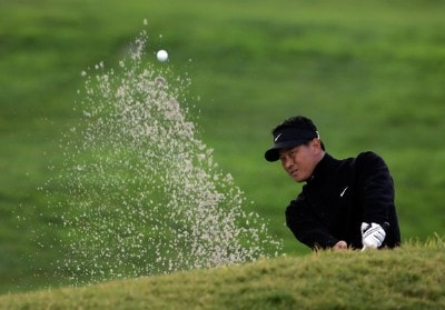K.J. Choi hits a bunker shot to the 14th green on the North Course during the first round of the Buick Invitational at the Torrey Pines Golf Course on January 24, 2008 in La Jolla, California. PGA TOUR - 2008 Buick Invitational - Round OnePhoto by Jeff Gross/Getty Images