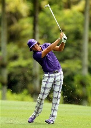 KUALA LUMPUR, MALAYSIA - OCTOBER 29: Rickie Fowler of theUSA hits his 2nd shot on the 12th hole during day two of the CIMB Asia Pacific Classic at The MINES Resort & Golf Club on October 29, 2010 in Kuala Lumpur, Malaysia. . (Photo by Stanley Chou/Getty Images)
