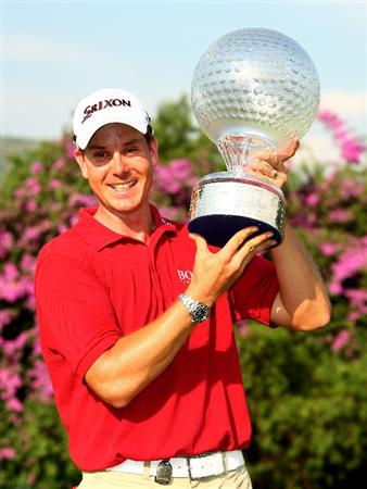 SUN CITY, SOUTH AFRICA - DECEMBER 07:  Henrik Stenson of Sweden poses with the trophy after the final round of the Nedbank Golf Challenge at the Gary Player Country Club on December 7, 2008 in Sun City, South Africa.  (Photo by Richard Heathcote/Getty Images)