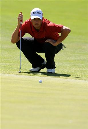 SANDY, UT - SEPTEMBER 10: Bradley Iles lines up his putt on the 17th hole of the Willow Creek Country Club during the second round of the Utah Championship on September 10, 2010 in Sandy, Utah. (Photo by Steve Dykes/Getty Images)