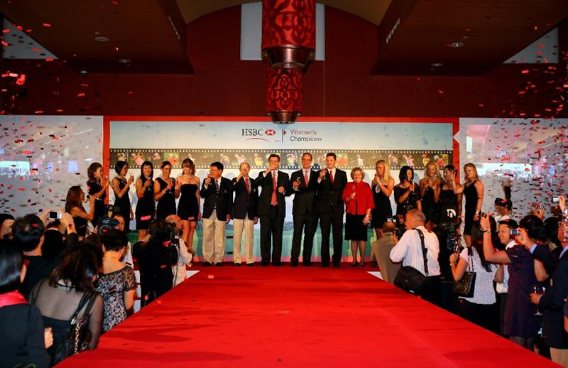 SINGAPORE - MARCH 04:  Players and dignitaries raise a glass to toast the success of the tournament during the Gala Dinner prior to the start of the HSBC Women's Championship at Tanah Merah Country Club on March 4, 2009 in Singapore.  (Photo by Andrew Redington/Getty Images)