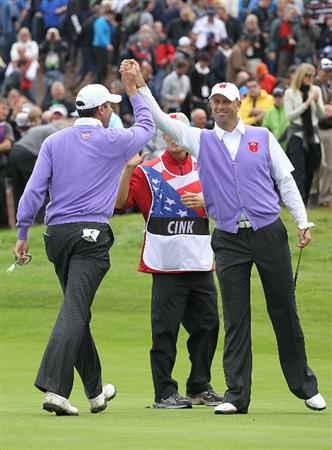 NEWPORT, WALES - OCTOBER 02:  Stewart Cink (R) of the USA celebrates his birdie putt on the 17th green with playing partner Matt Kuchar during the rescheduled Afternoon Foursome Matches during the 2010 Ryder Cup at the Celtic Manor Resort on October 2, 2010 in Newport, Wales.  (Photo by Andy Lyons/Getty Images)