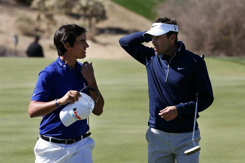 MARANA, AZ - FEBRUARY 24:  Charl Schwartzel of South Africa (R) congratulates Matteo Manassero of Italy (L) on his win on the 18th hole during the second round of the Accenture Match Play Championship at the Ritz-Carlton Golf Club on February 24, 2011 in Marana, Arizona.  (Photo by Sam Greenwood/Getty Images)