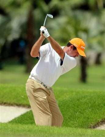 SINGAPORE - NOVEMBER 13: Anders Hansen of Denmark plays a bunker shot on the 6th hole during the Third Round of the Barclays Singapore Open held at the Sentosa Golf Club on November 13, 2010 in Singapore, Singapore (photo By: Stanley Chou/Getty Images)