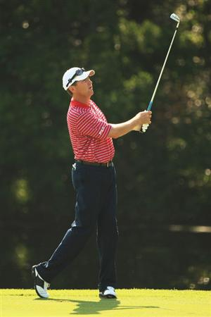 PONTE VEDRA BEACH, FL - MAY 07:  Davis Love III hits his second shot on the 14th hole during the first round of THE PLAYERS Championship on THE PLAYERS Stadium Course at TPC Sawgrass on May 7, 2009 in Ponte Vedra Beach, Florida.  (Photo by Jamie Squire/Getty Images)