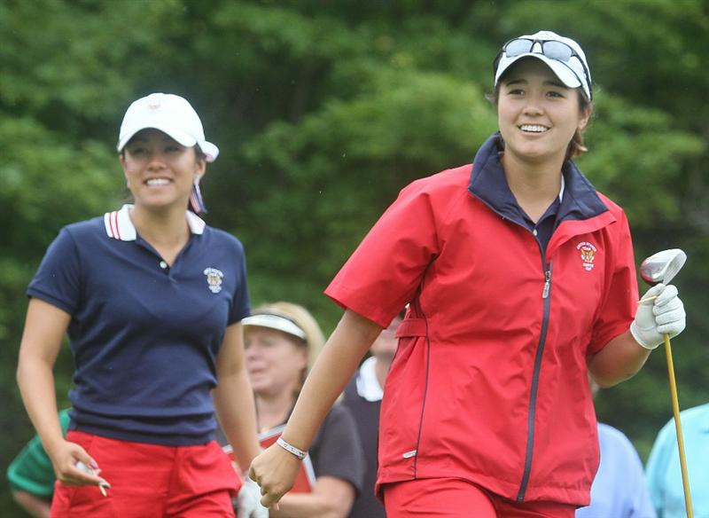 MANCHESTER, MA - JUNE 12:  Stephanie Kono (L) and Kimberly Kim of the United States watch the flight of Kim's tee shot in Four Ball competition during the second day of the 2010 Curtis Cup Match at the Essex Country Club on June 12, 2010 in Manchester, Massachusetts. (Photo by Jim Rogash/Getty Images)