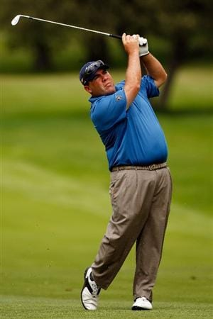 GRAND BLANC, MI - AUGUST 01:  Kevin Stadler hits his second shot on the 4th hole during round three of the Buick Open at Warwick Hills Golf and Country Club on August 1, 2009 in Grand Blanc, Michigan.  (Photo by Chris Graythen/Getty Images)