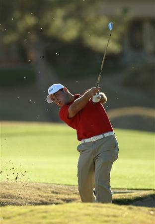 LA QUINTA, CA - JANUARY 21:  Gary Woodland hits from a fairway bunker on the 18th hole during round three of the Bob Hope Classic at the Nicklaus Private Course at PGA West on January 21, 2011 in La Quinta, California.  (Photo by Stephen Dunn/Getty Images)