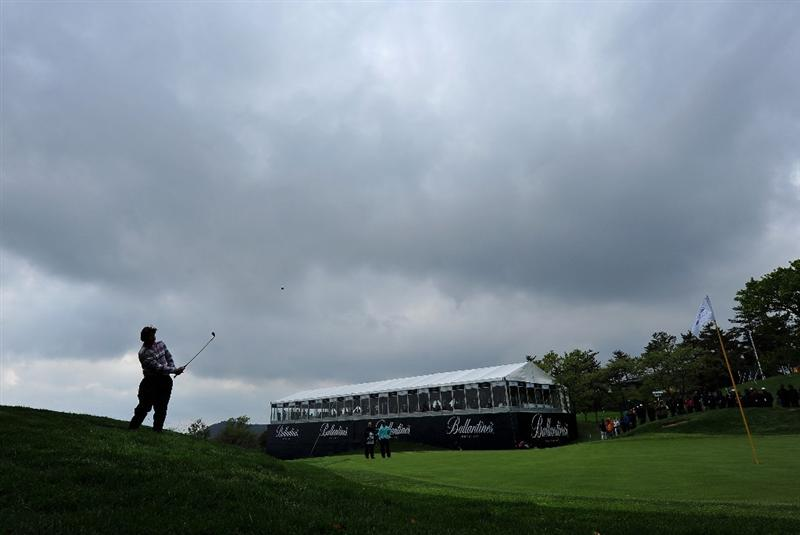 JEJU, SOUTH KOREA - APRIL 25:  Robert - Jan Derksen of The Netherlands plays his approach shot on the nineth hole during the third round of the Ballantine's Championship at Pinx Golf Club on April 25, 2009 in Jeju, South Korea.  (Photo by Stuart Franklin/Getty Images)