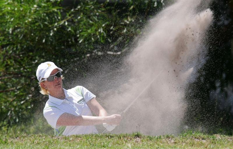 MELBOURNE, AUSTRALIA - MARCH 14:  Karrie Webb of Australia plays a shot out of a bunker on the 6th hole during the final round of the 2010 Women's Australian Open at The Commonwealth Golf Club on March 14, 2010 in Melbourne, Australia.  (Photo by Scott Barbour/Getty Images)