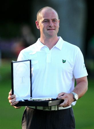 VIRGINIA WATER, ENGLAND - MAY 23:  Craig Lee of Scotland poses with the Silver Salver for top PGA Pro at the end of the final round of the BMW PGA Championship on the West Course at Wentworth on May 23, 2010 in Virginia Water, England.  (Photo by Richard Heathcote/Getty Images)