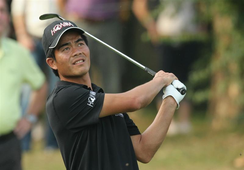 HONG KONG - NOVEMBER 19: Liang Wen-Chong of China watches his 2nd shot on the 18th hole during day two of the UBS Hong Kong Open at The Hong Kong Golf Club on November 19, 2010 in Hong Kong, Hong Kong.  (Photo by Stanley Chou/Getty Images)