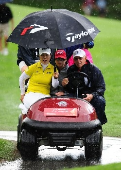OTTAWA - AUGUST 15:  Meena Lee of South Korea and Paula Creamer get a ride back to the clubhouse because of a rain delay as they were playing on the 13th hole during the second round of the CN Canadian Women's Open at the Ottawa Hunt and Golf Club on August 15, 2008 in Ottawa, Ontario, Canada.  (Photo by Robert Laberge/Getty Images)